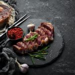 Grilled,Sliced,Beef,Steak,With,Rosemary,And,Spices,On,A