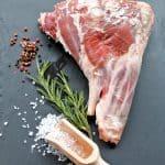 Raw,Lamb,Leg,With,Crystal,Salt,And,Rosemary