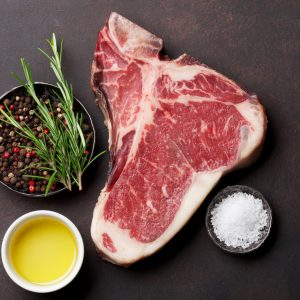 Raw,T Bone,Steak,Cooking,On,Stone,Table.,Top,View,With